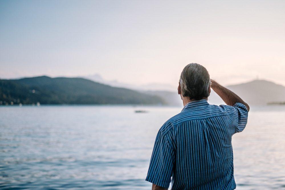 man on bus tour looking to horizon